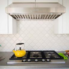 Kitchen Range With White Lantern Tile Backsplash