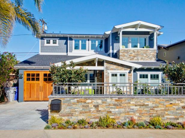 Eclectic, Blue Beach House Exterior With Stacked Stone Wall