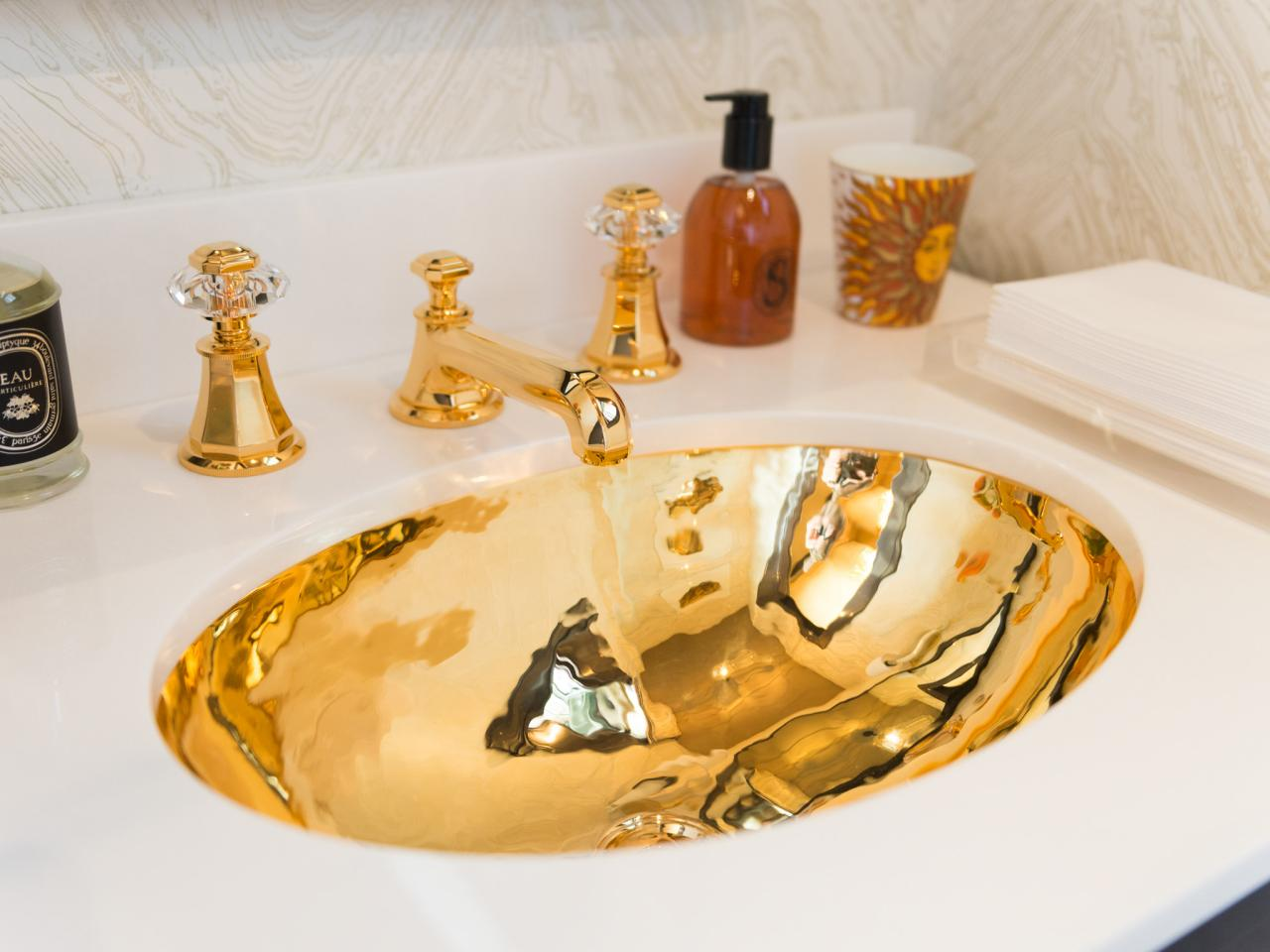Our Favorite Gold Silver And Bronze Decor HGTVs Decorating - Silver and gold bathroom fixtures
