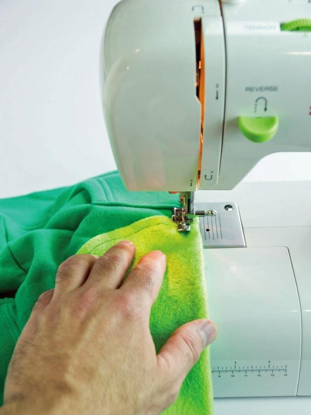 Sew the tummy pieces in place with sewing machine.