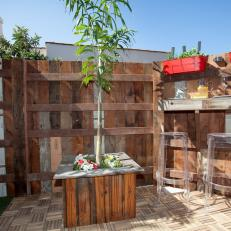 Patio With Wood Fence and Small Container Garden