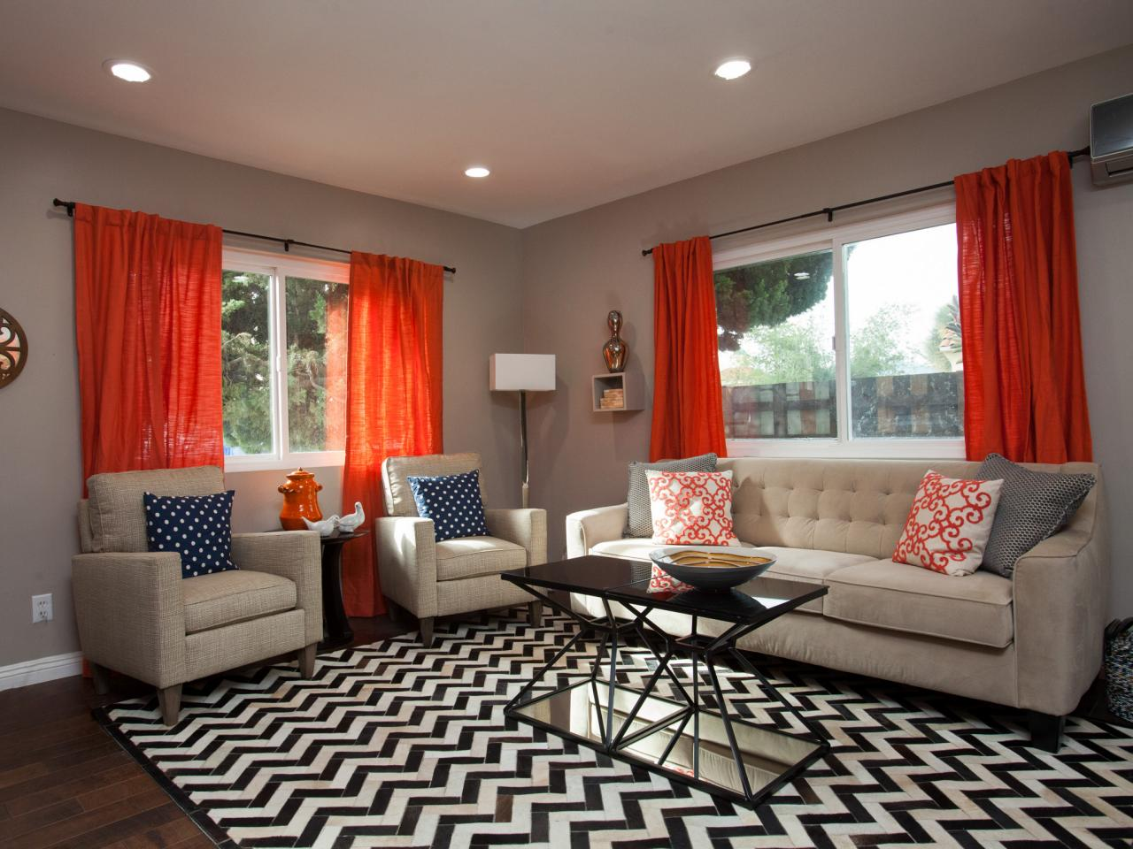 Taupe Living Room With Orange Curtains And Chevron Rug Hgtv