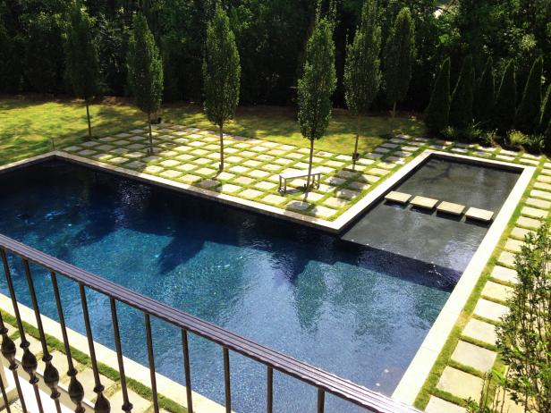 Swimming Pool With Columnar Trees & Stone Grid Patio