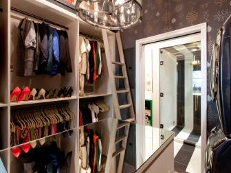 Walk-In Closet With Purple Wallpaper and Mirrored Table