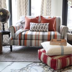 Lovely Sitting Room With Striped Sofa And Accents