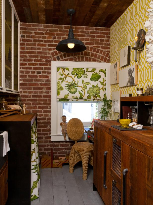 Utility Room With Brick Walls, Yellow Trellis Wallpaper and Wood Cabinet