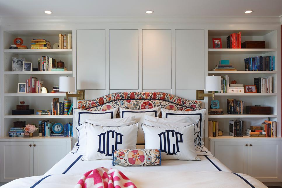 White Traditional Bedroom With Built-in Bookshelves & Floral Headboard