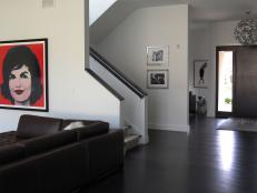 Brown and White Modern Foyer With Jackie O. Portrait