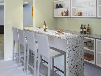 Speckled Bar With White Barstools