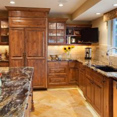 Craftsman Kitchen With Wood Paneled Refrigerator