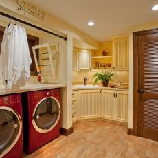 Traditional Cream Laundry Room With Cherry Red Washer and Dryer