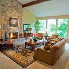 Bright Craftsman Living Room With Natural Stone Fireplace and Large Wall of Windows
