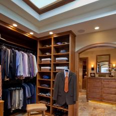 Traditional Men's Walk-In Closet With Large Skylight