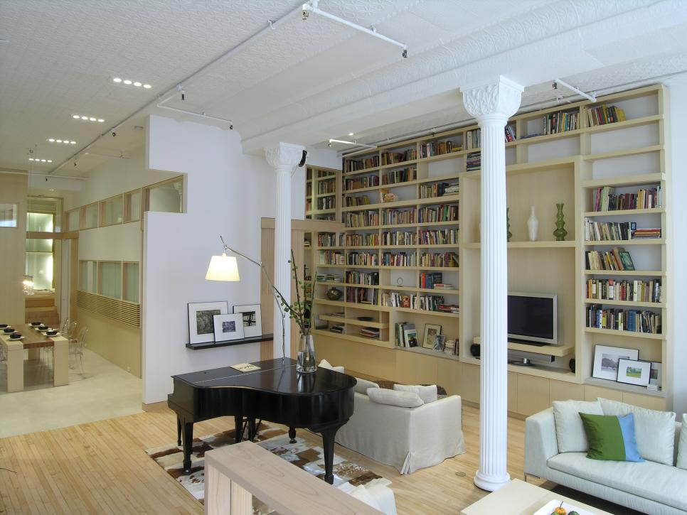 White Living Room With Large Bookshelf