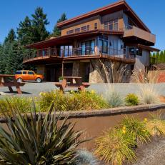 Sunny Winery Home With Wrap Around Porch, Large Driveway and Mixed Textures