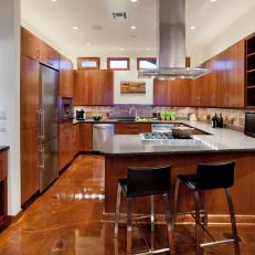 Modern Winery Kitchen With Wood Cabinetry & Brown Marble Flooring