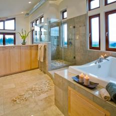 Luxe Spa Bathroom With Square Soaking Tub, Glass Shower and Pebble Floor Mosaic