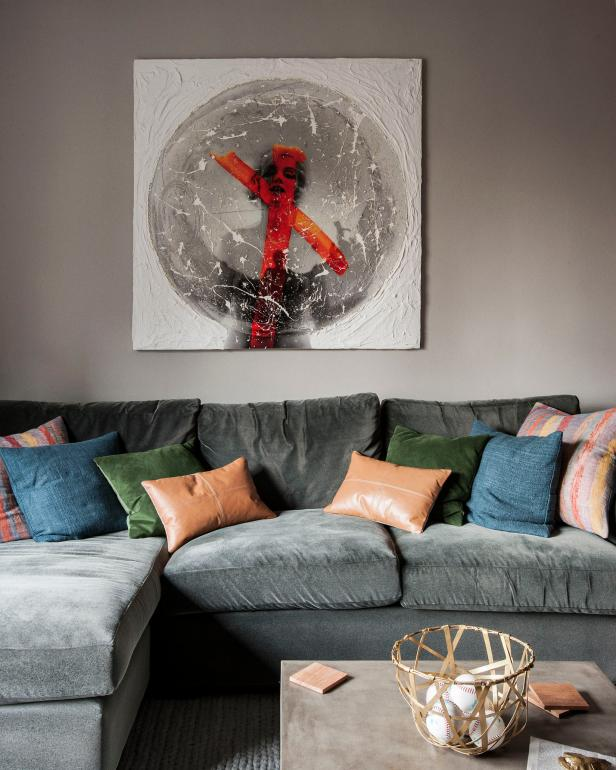 Artwork Above Gray Sectional With Multicolored Throw Pillows