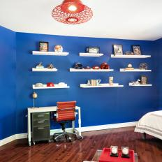 Blue Kid's Bedroom With White Shelves