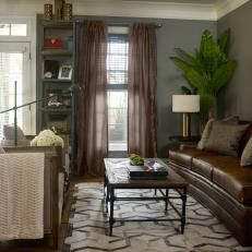 Transitional Living Room With Neutral Tones, Brown Leather Sofa and Sheer Curtains