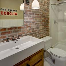 Modern Basement Bathroom With Red Brick Accent Wall