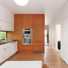 Bright, Modern Kitchen With White Laminate Cabinets, Vertical Woodgrain Room Divider Wall and Long Window