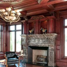 Traditional Living Space with Paneled Walls, Marble Fireplace