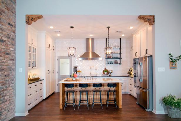 Kitchen With Large Center Island and Industrial Pendant Lights