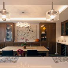 Warm Contemporary Kitchen Opens to Dining Room