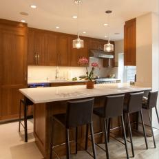 Warm Contemporary Kitchen With Dining Peninsula