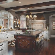 Warm, Traditional Kitchen With White and Wood Cabinetry