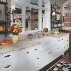Traditional Kitchen With Arched Window and White Cabinets