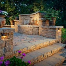 Backyard Patio With Paver Stairs And Water Feature