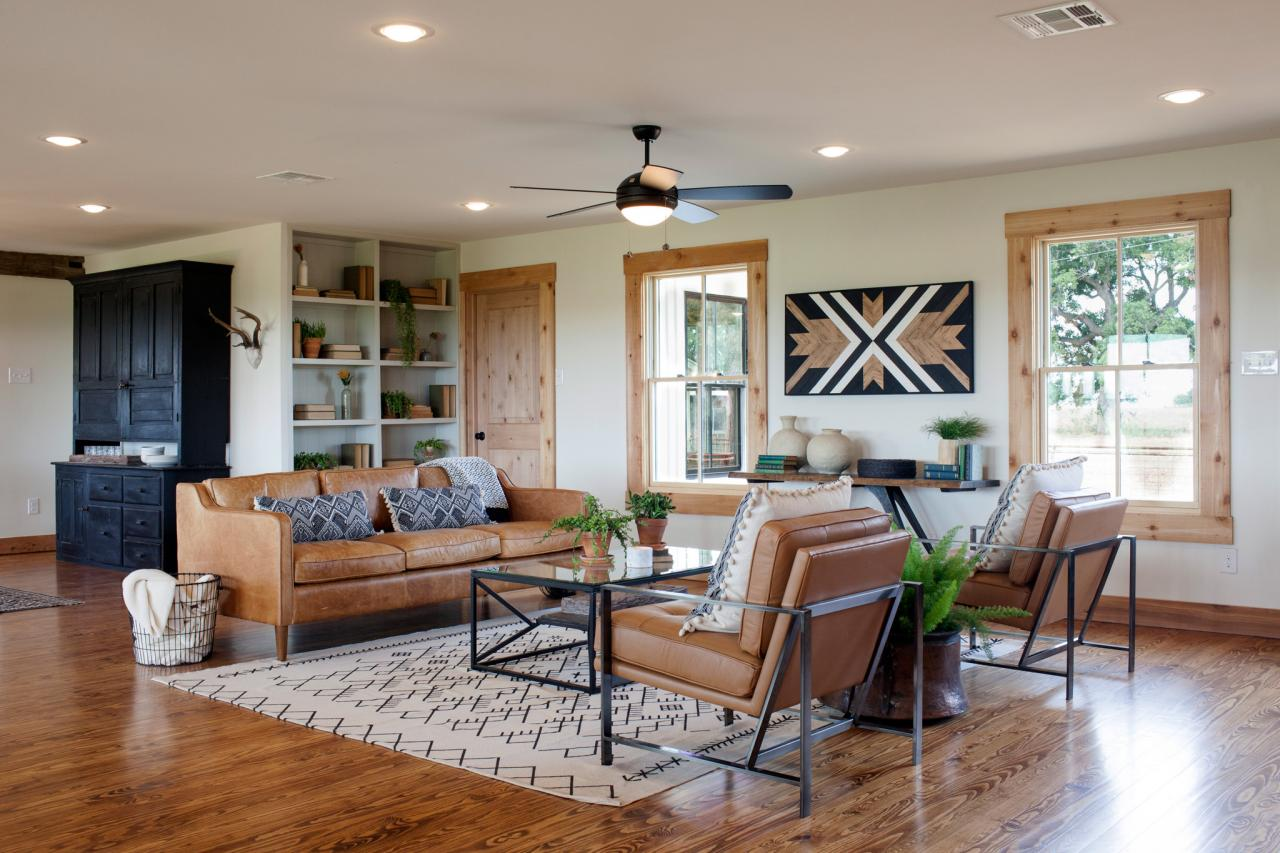 Wood floors and graphic carpet add brightness to living room