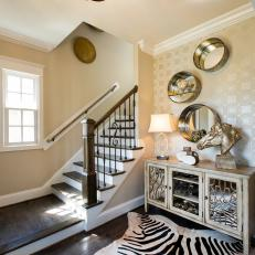 Transitional Foyer With Metallic Accents, Zebra Area Rug