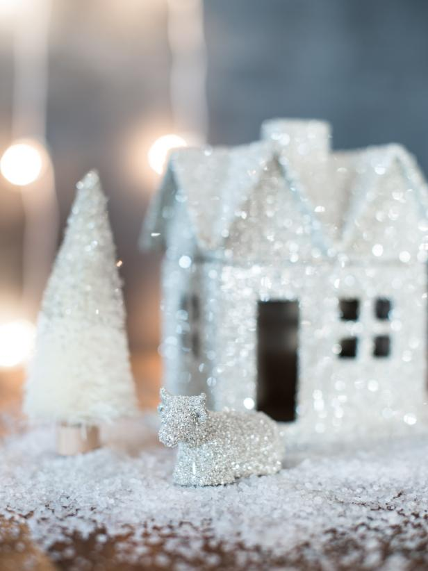 Inexpensive papier mache houses can become sparkling Christmas decorations with just some simple glue and German glass glitter. This glitter sparkles like no other and can make these simple objects look high-end.