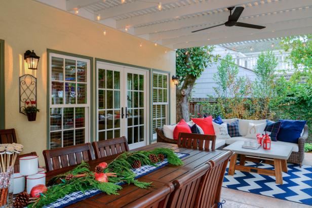 Outdoor Dining Table Topped With Holiday Garland