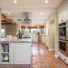 French Country Kitchen With Spacious Peninsula