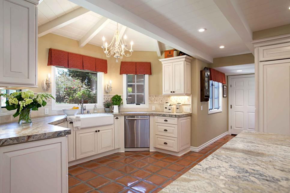 French Country Neutral Kitchen With White Cabinets and Red Tile Floors