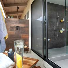 Outdoor Shower Area With Wood and Frosted Glass Perimeters and Glass Sliding Door To Indoor Bathroom