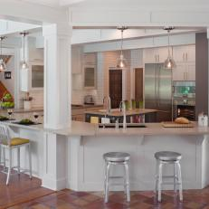 Transitional White Kitchen With Spacious Breakfast Bar