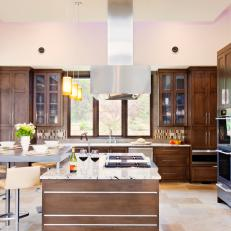 Brown and White Contemporary Chef's Kitchen With Range Hood