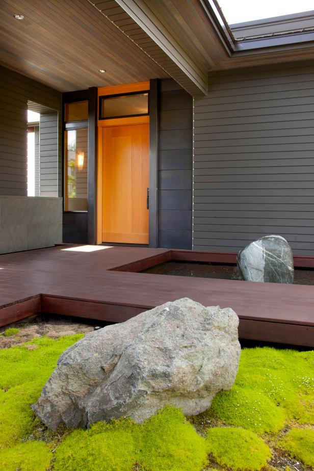 Contemporary Covered Porch and Orange Wood Door