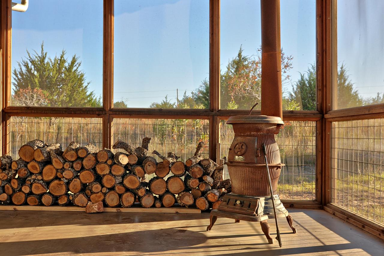 Rustic Screened In Porch Features Wood Burning Stove Hgtv