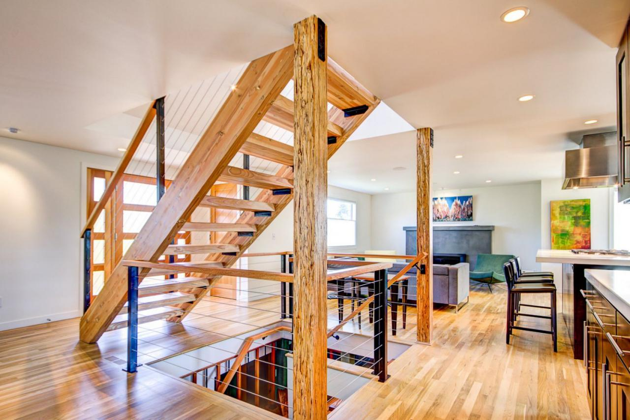 Bright Open Plan Living E With Floating Wood Staircase