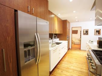 Midcentury Modern Galley Kitchen With Wood Cabinetry