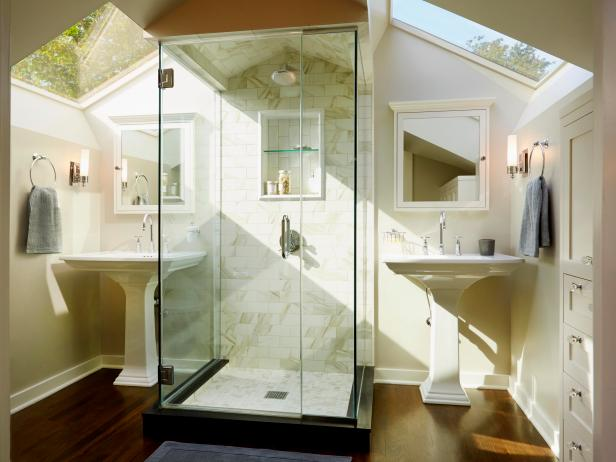 White Bathroom With Two Pedestal Sinks & Skylights