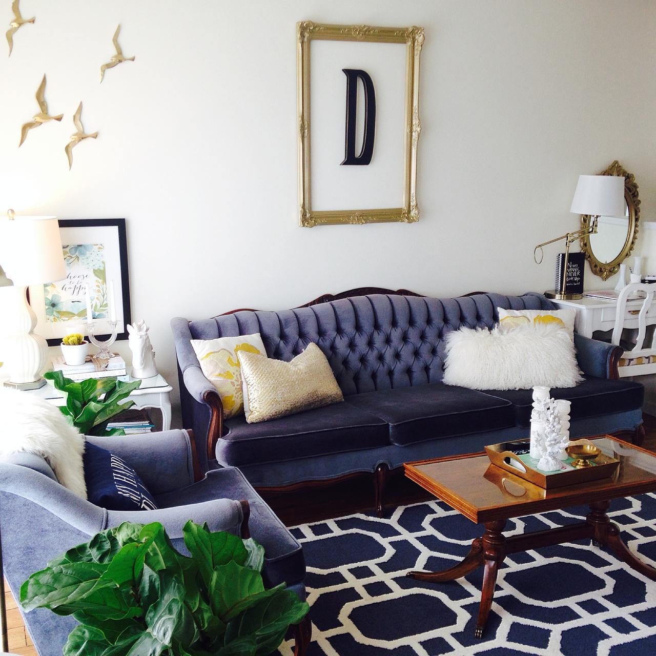 Navy and white living room with tufted sofa