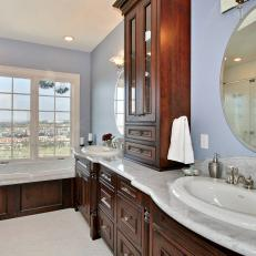 Blue Traditional Bathroom With Wood Cabinetry
