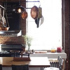 Rustic, Industrial Kitchen With Exposed Brick Walls